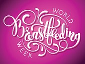 World breastfeeding week hand lettering on pink background