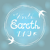 World Earth Day hand littering. Swallows fly around the planet.