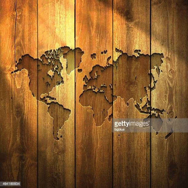 World Map on lit Wooden Background