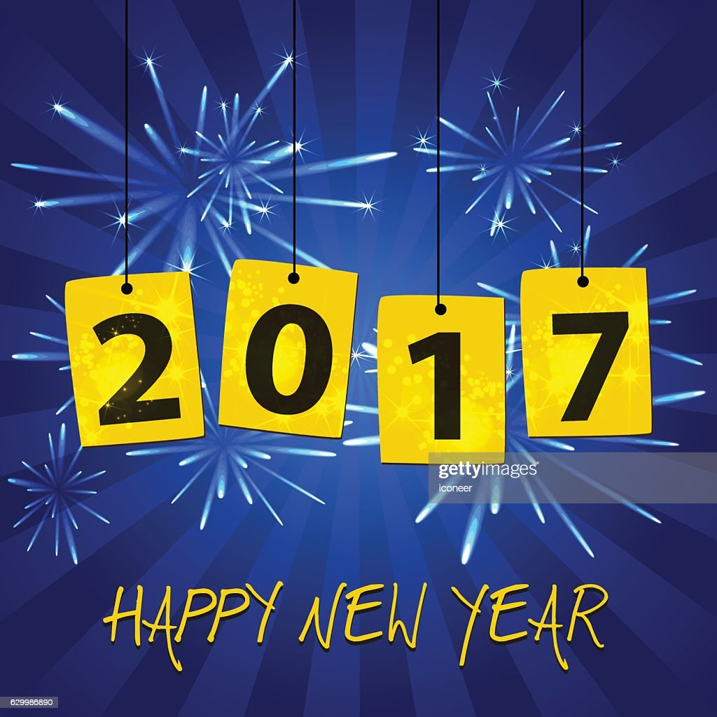 year 2017 label at new years eve blue fireworks background vector art
