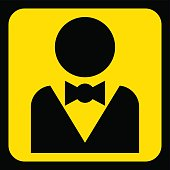 yellow, black sign - figure with suit and bow tie