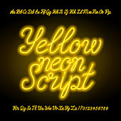 Yellow neon script alphabet font. Neon uppercase and lowercase letters.