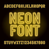 Yellow neon tube alphabet font. Neon color letters, numbers and symbols.