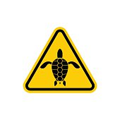 Yellow sign attention water turtle. Marine reptile on yellow tri