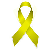 Yellow textile ribbon emblem of fight against suicide.