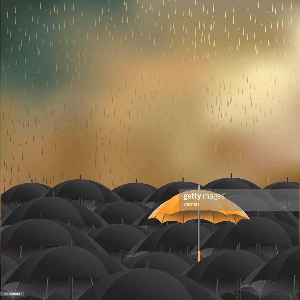 Yellow umbrella in sea of black background