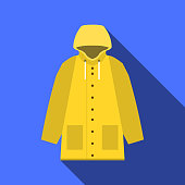 Yellow vintage raincoat icon in flat design with long shadow on blue background