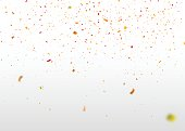 Yellow-red confetti falling randomly. Abstract background with flying particles.