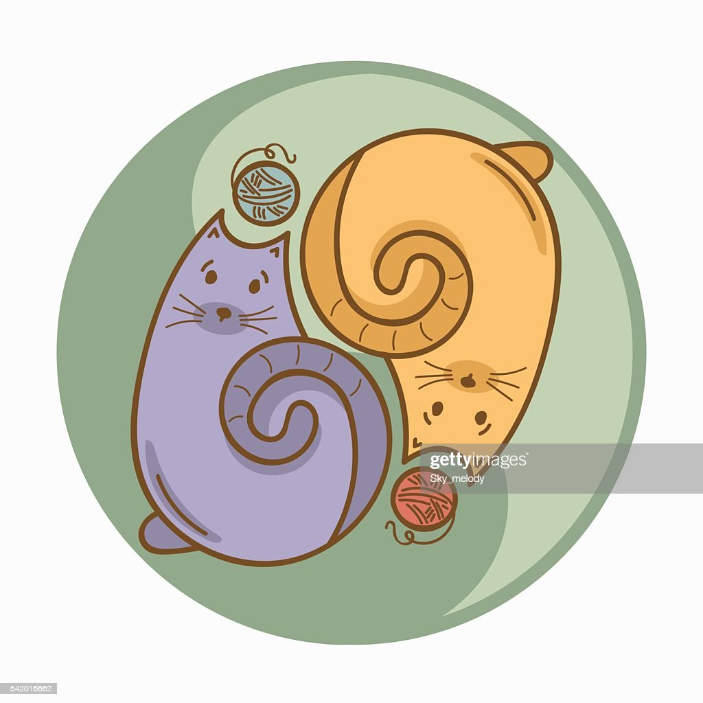 Yin-Yang sign or symbol with cats and wool thread bolls