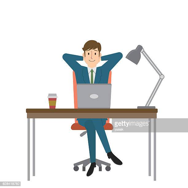 Young businessman relaxing at his desk