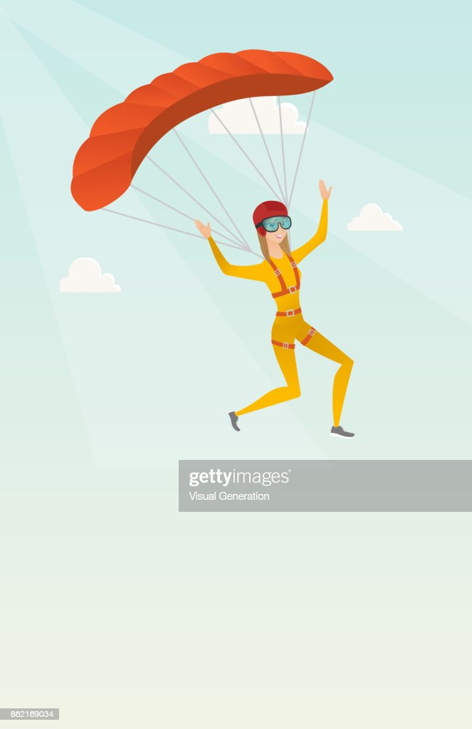 Young caucasian skydiver flying with a parachute