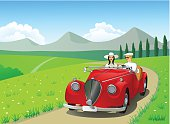 Young couple drive with a vintage car in the mountains