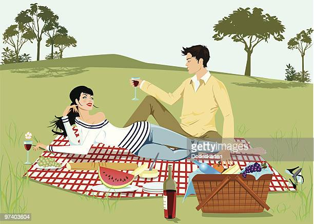 Young Couple Having Picnic in Park