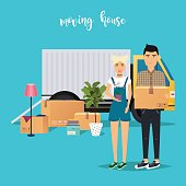 Young Couple Moving. Moving truck and cardboard boxes. Shipping