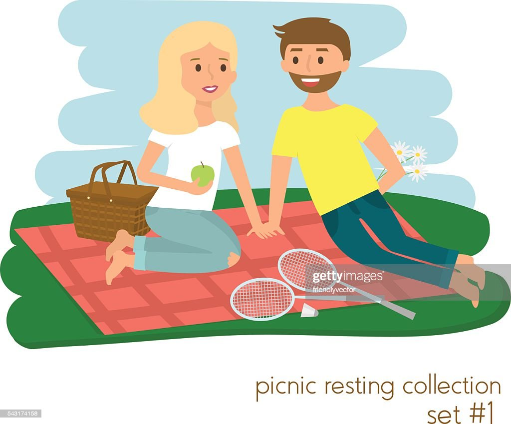 Young couple on picnic together. Family picnic vacation.