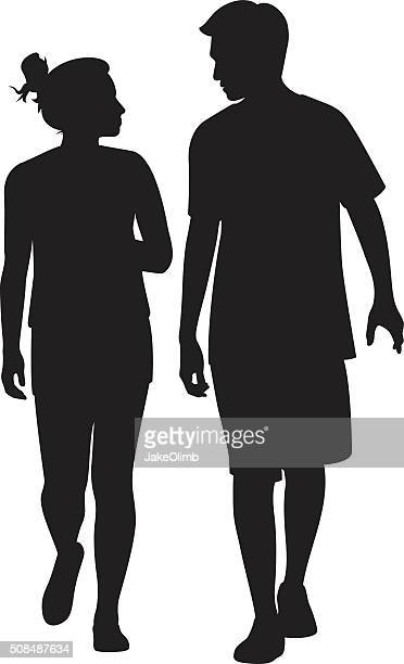 young couple walking and looking at each other silhouette - boyfriend stock illustrations, clip art, cartoons, & icons