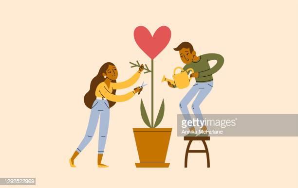 ein junges paar arbeitet zusammen, um ihre liebesbeziehung zu verbessern - hingabe stock-grafiken, -clipart, -cartoons und -symbole