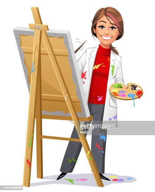 Jonge vrouwelijke artiest schilderen van een foto