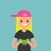 Young female character playing with a slime / flat editable vector illustration, clip art