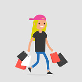 Young female trendy character walking with the shopping bags / flat editable vector illustration