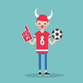 Young football fan wearing horned hat and foam finger / flat editable vector illustration, clip art