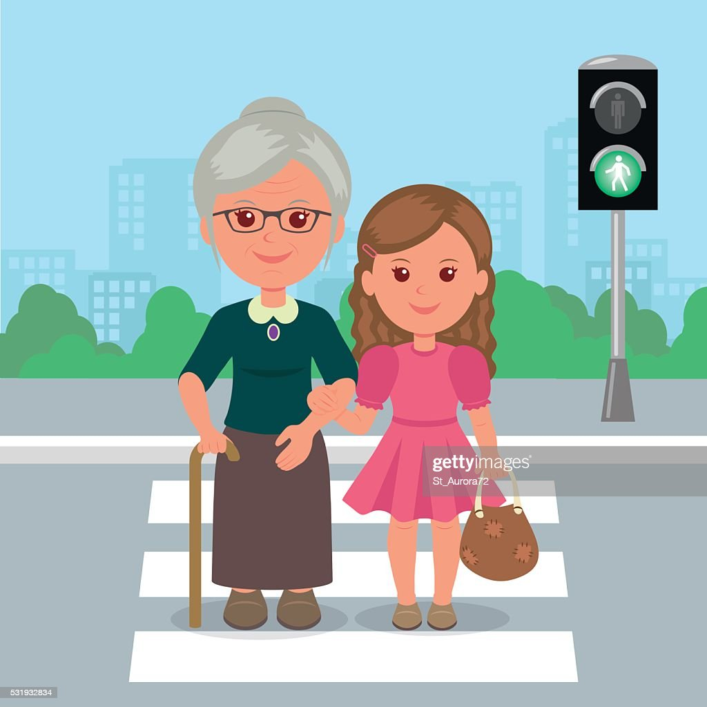 Young girl helps old woman to cross the road.