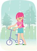 young girls and bike in the rain
