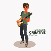 Young guitarist plays on the electric guitar. Creative people
