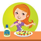 Young happy woman enjoying vegetable salad