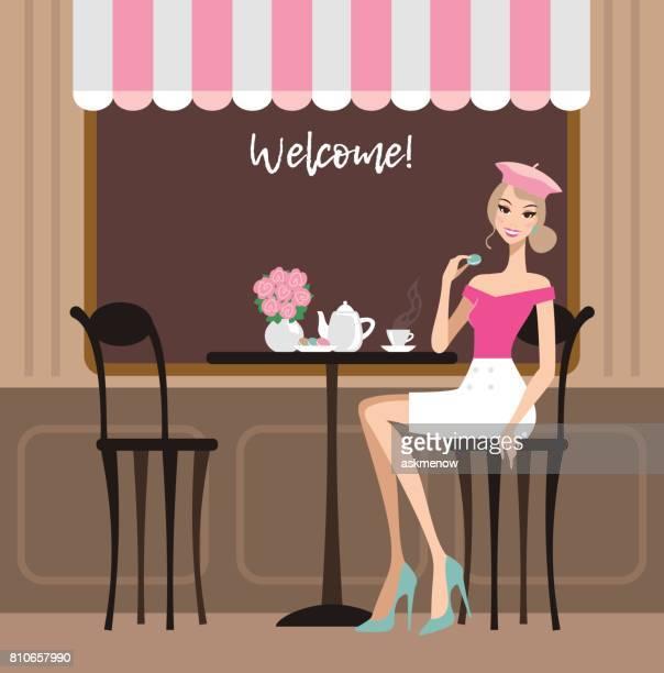ilustrações de stock, clip art, desenhos animados e ícones de young happy woman in a cafe - mesa cafe da manha