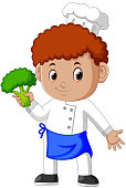 Young male chef holding fresh broccoli