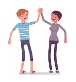Young man and woman giving high five
