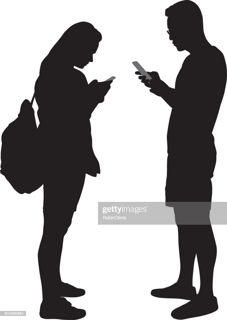 Young Man And Woman Using Smart Phones Silhoettes