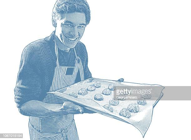 Young man baking cookies
