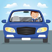 Young man driving blue car on the road