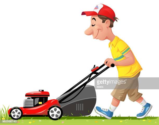 Young Man Mowing Grass