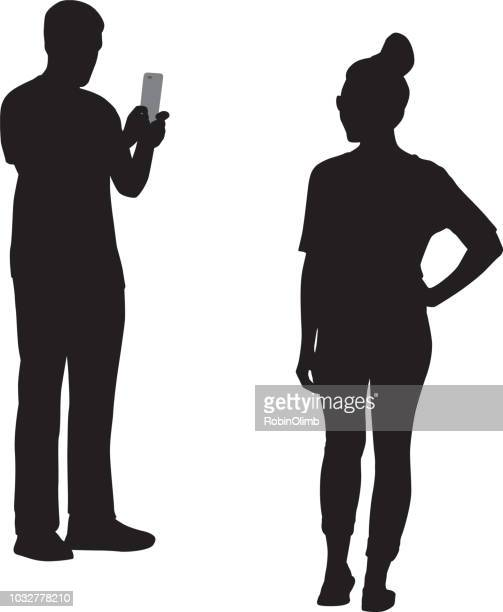 young man photographing girl silhouette - holding stock illustrations