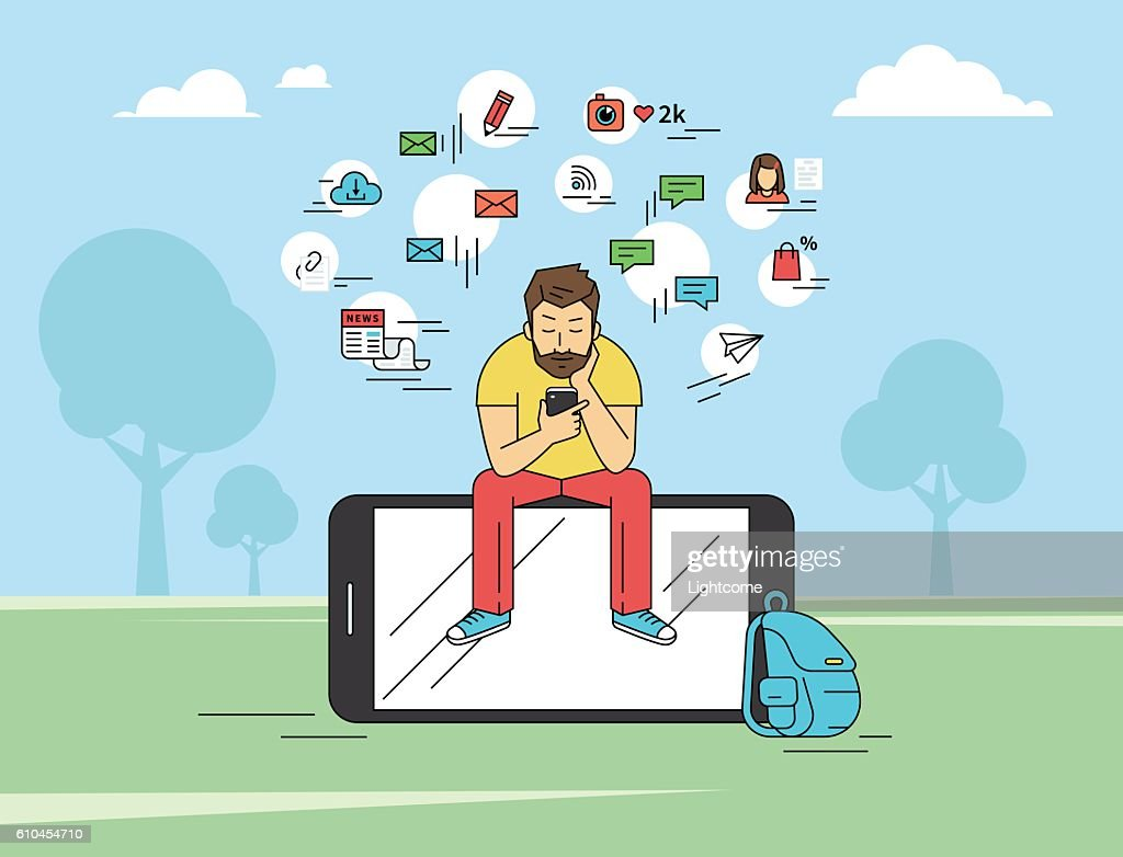 Young man sitting in the park and texting messages using