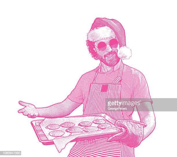 young man wearing santa hat baking cookies - baked stock illustrations, clip art, cartoons, & icons