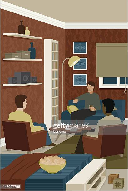 Young Men Sitting in Living Room Talking and Eating Snacks