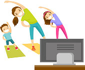 Young mother and her kids doing gymnastics at home