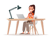 Young mother sits with a baby and works at a laptop. Mother freelancer, remote work at home and raising a child