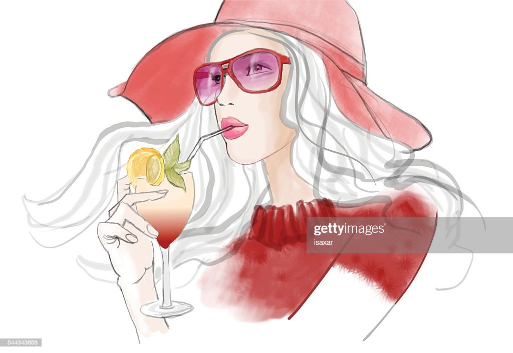 Young pretty woman with hat having a cocktail