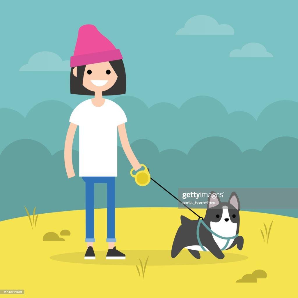Young smiling girl walking the dog / flat editable vector illustration