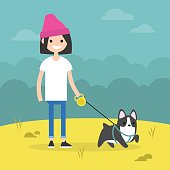 Young smiling girl walking the dog / flat editable vector illustration