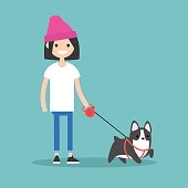 Young smiling girl walking the dog