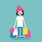 Young trendy girl holding shopping bags