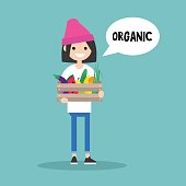 Young vegetarian brunette girl holding a crate