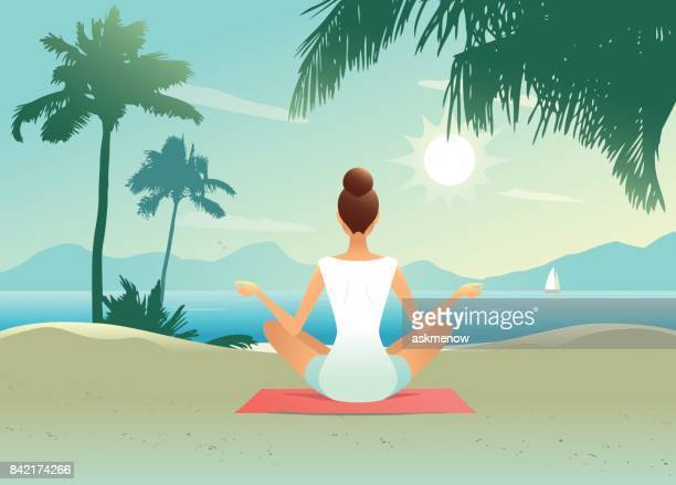 young woman doing yoga on the beach - yoga instructor stock illustrations, clip art, cartoons, & icons