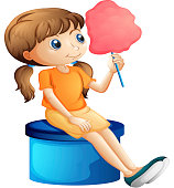 Young woman eating a cotton candy
